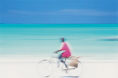 Photo of a cyclist in Zanzibar by Peter Adams