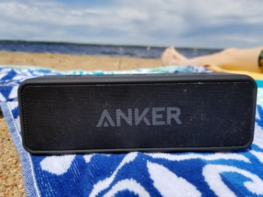 Anker Soundcore 2 sitting on beach towel