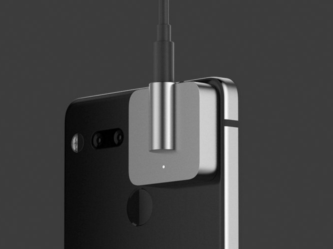 similar to the 360 camera this headphone jack adapter snaps onto the back of the essential phone using its two pin connection system and strong magnets  [ 1339 x 1004 Pixel ]