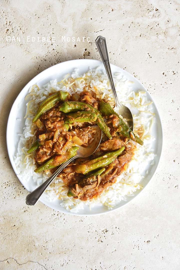 White Plate with Persian Okra Stew (Khoresh Bamieh) on Concrete Background