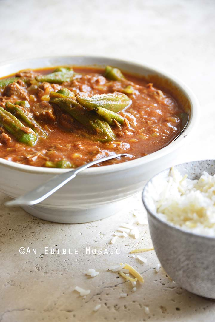 Front View of Persian Okra Stew (Khoresh Bamieh) with Spoon
