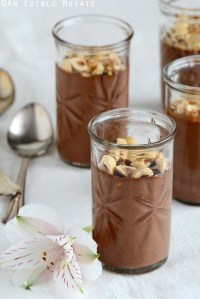 Chocolate-Hazelnut Custard on a White Fabric with an Exotic Flower Front View Vertical Orientation