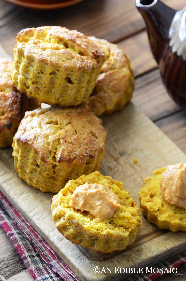 Pumpkin Spice Scones Recipe on Wooden Board with Cinnamon Pumpkin Cream
