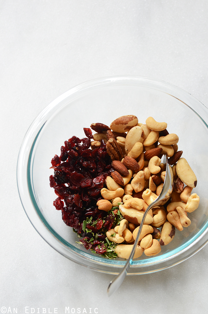 Festive Vanilla Bean Mixed Nuts with Rosemary and Cranberries In Mixing Bowl
