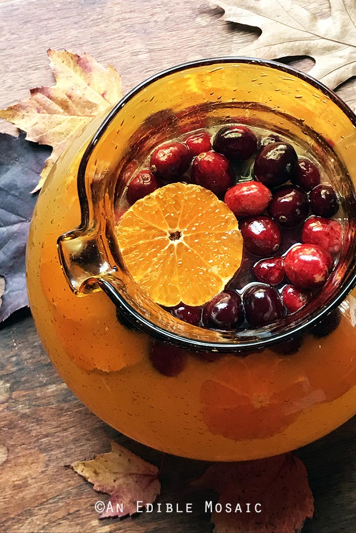 tangerine-lemonade-with-clove-infused-simple-syrup-and-fresh-cranberries-3