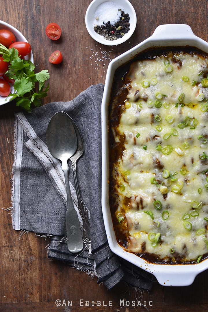 Low Carb Chicken Enchiladas Recipe in White casserole Dish on Wooden Table