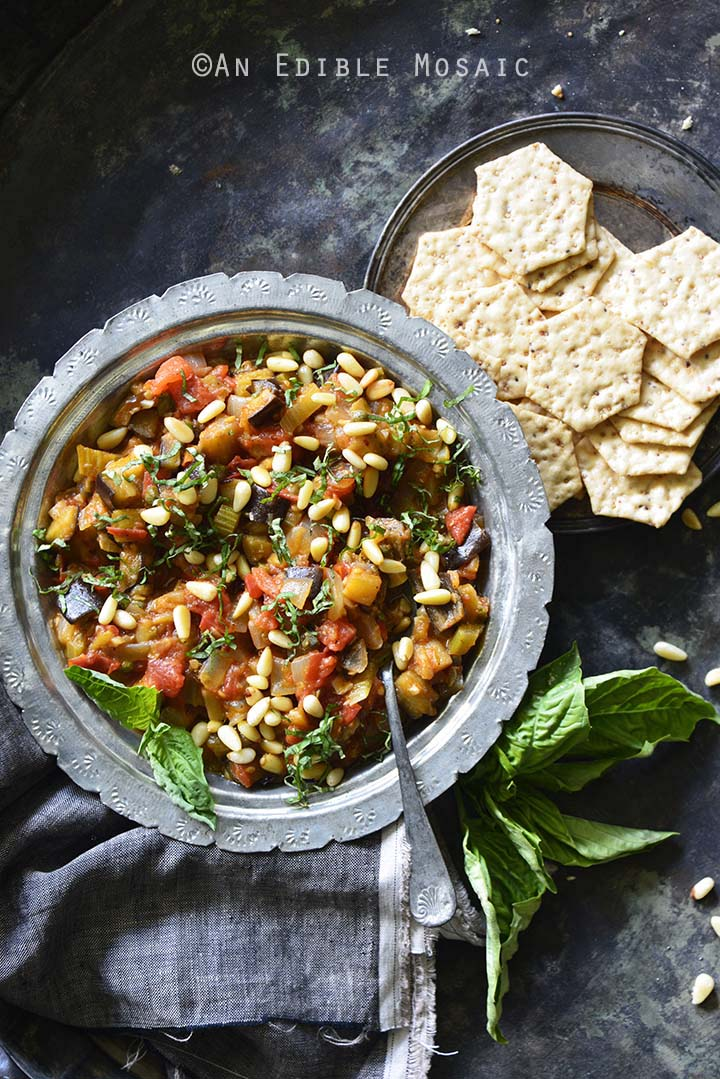 Caponata {aka Sicilian Eggplant Relish} with Crackers Top View on Metal Tray Background