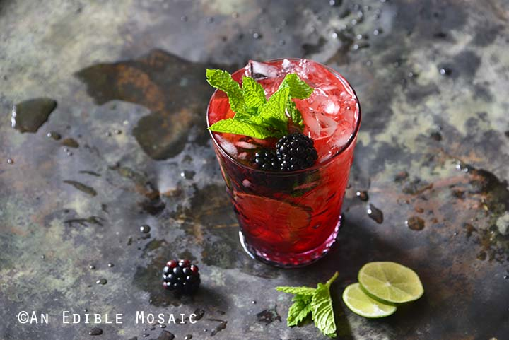 Blackberry Syrup, Mint, and Lime Spritzers on Metal Tray Front View Horizontal Orientation