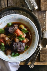 Braised Beef with Root Vegetables and Red Wine on Wooden Table Top View