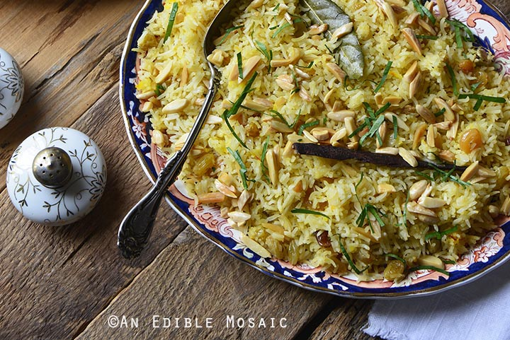 Orange and Toasted Almond Saffron Rice Pilaf with Golden Raisins Front View on Wooden Table Horizontal Orientation