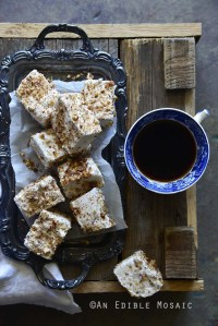 Vanilla Bean and Maple Toasted Pecan Marshmallows on Metal Tray on Wooden Table with Coffee