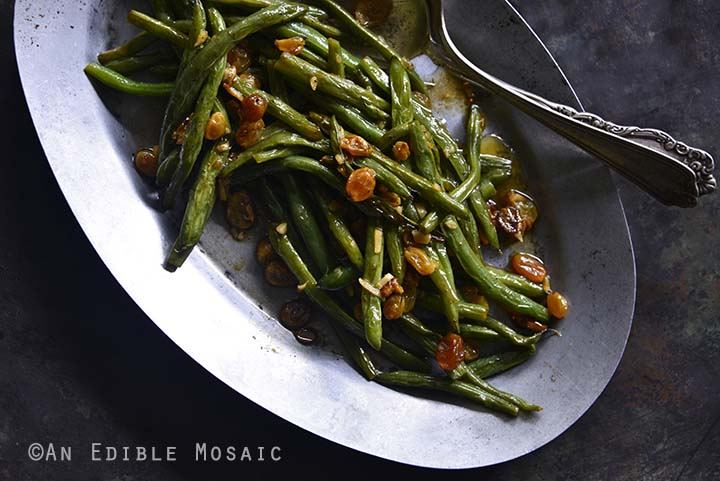 Green Beans with Garlic and Golden Raisins on Metal Tray Horizontal Orientation