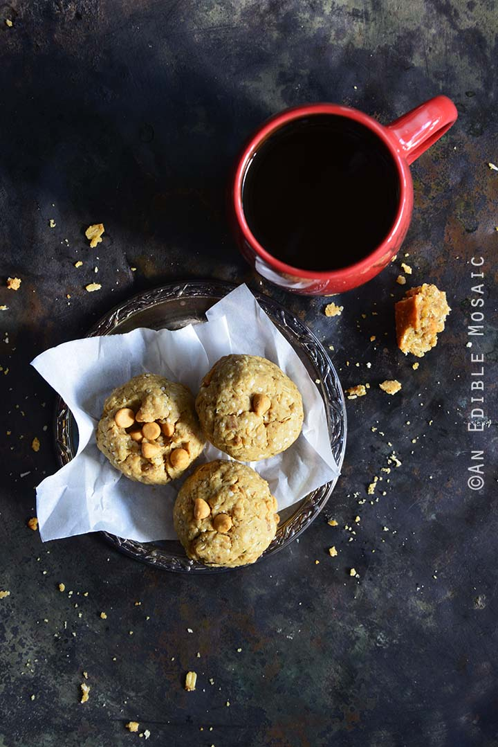 Coconut Butterscotch Granola Cookies on Small Plate with Coffee Mug