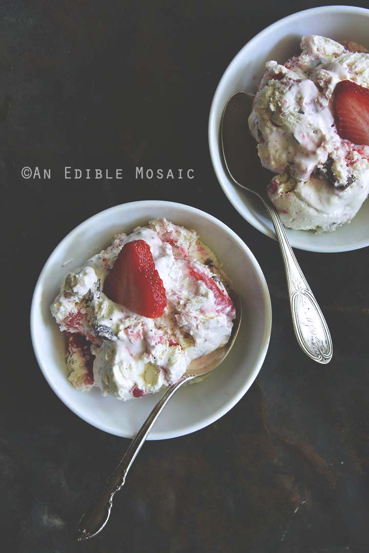 Multiple Bowls of Low-Carb Keto No-Churn Vanilla Cheesecake Ice Cream with Strawberry Swirl and Chocolate Chunks