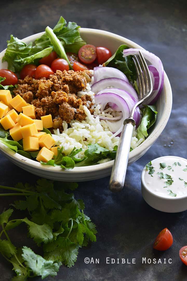 Putting Together Turkey Taco Rice Salad Bowls with Creamy Tex-Mex Dressing