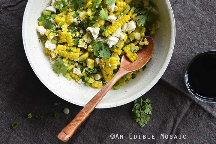 Close Up of Mexican-Inspired Warm Garlic Butter Corn Salad with Cotija