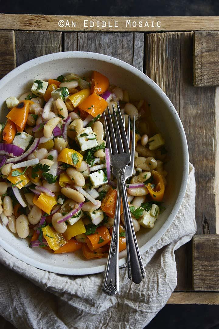White Bean Roasted Bell Pepper Salad with Maple Dijon Vinaigrette on Wooden Table