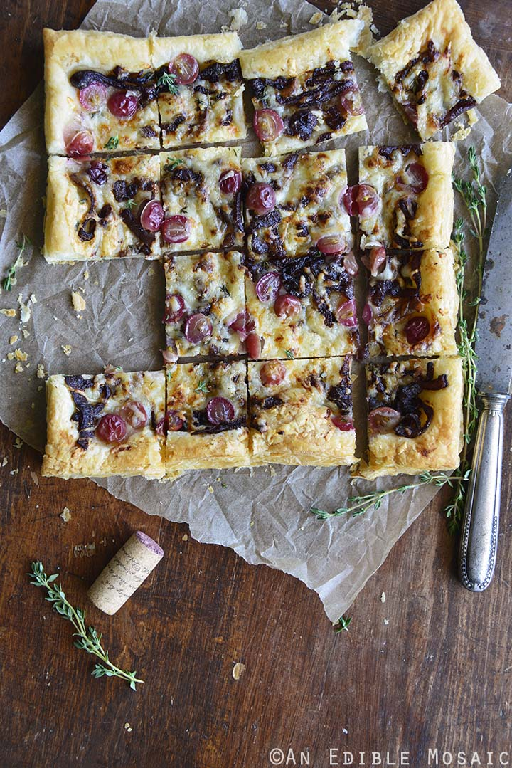 Easy Manchego, Grape, and Thyme Flatbread with Red Wine Caramelized Onions on Wooden Table