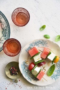 Watermelon Salad Skewers with Tomato, Basil, and Feta on White Table