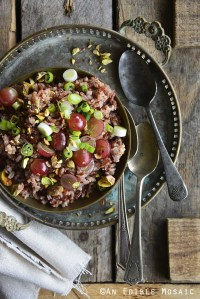 Red Rice Recipe with Grapes and Pistachios on Wooden Table