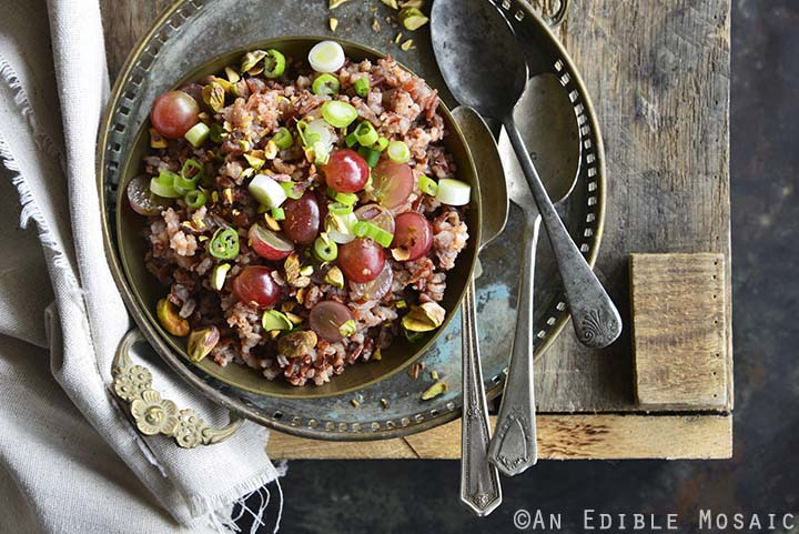 Close Up of Red Rice Recipe with Grapes and Pistachios