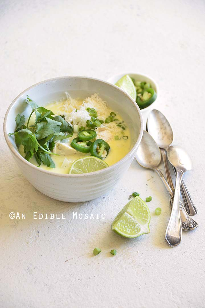 Front View of Creamy White Chicken Chili Recipe (Beanless; Keto; Low Carb) with Lime, Scallion, and Cilantro