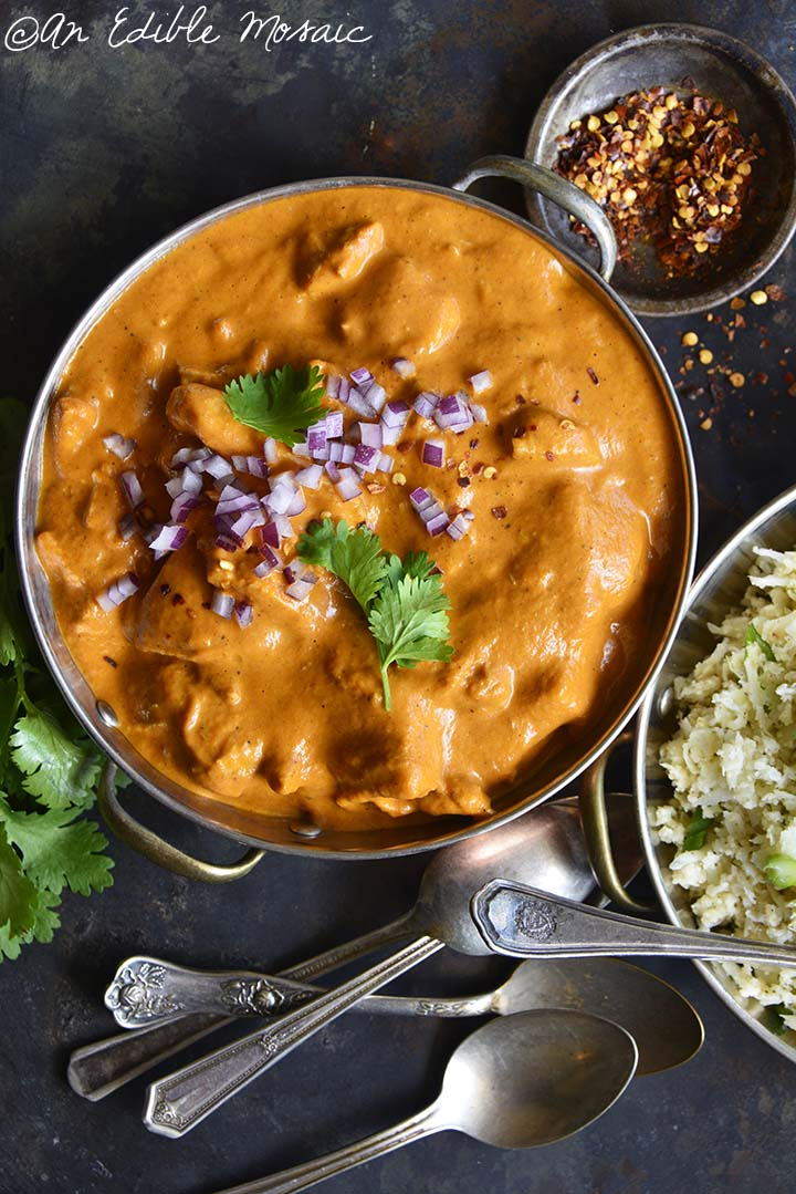 Top View of Easy Low Carb Butter Chicken with Vintage Spoons on Metal Background