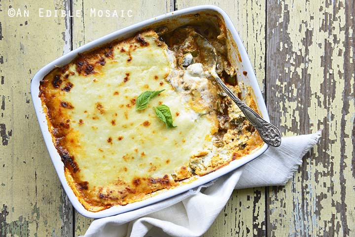 Low Carb Noodle Free Lasagna Recipe in White Casserole Dish with White Linen on Rustic Yellow Table