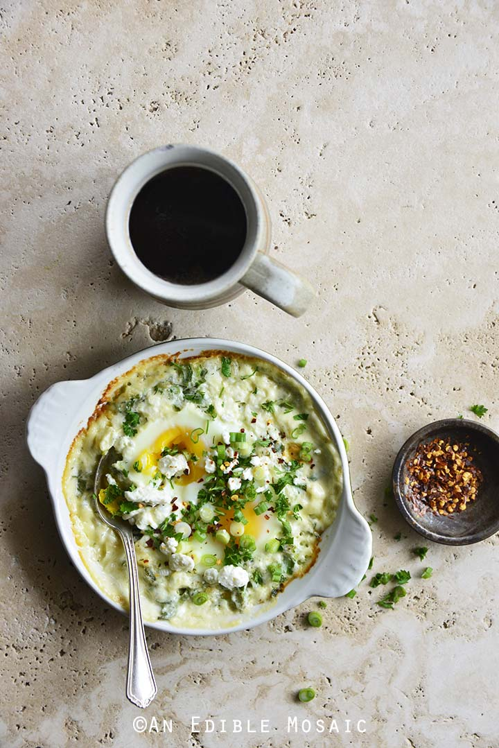 Herbed Eggs Baked in Cream with Feta and Coffee on Creamy Marble Background