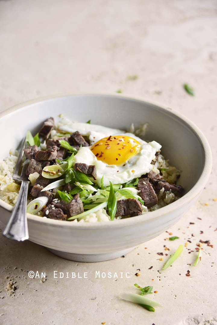 Front View of Low Carb Chili Garlic Steak Rice Bowl with Fried Egg