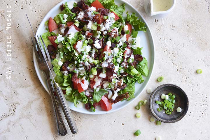 Top View of Healthy BLT Salad with Fork and Knife on Plate