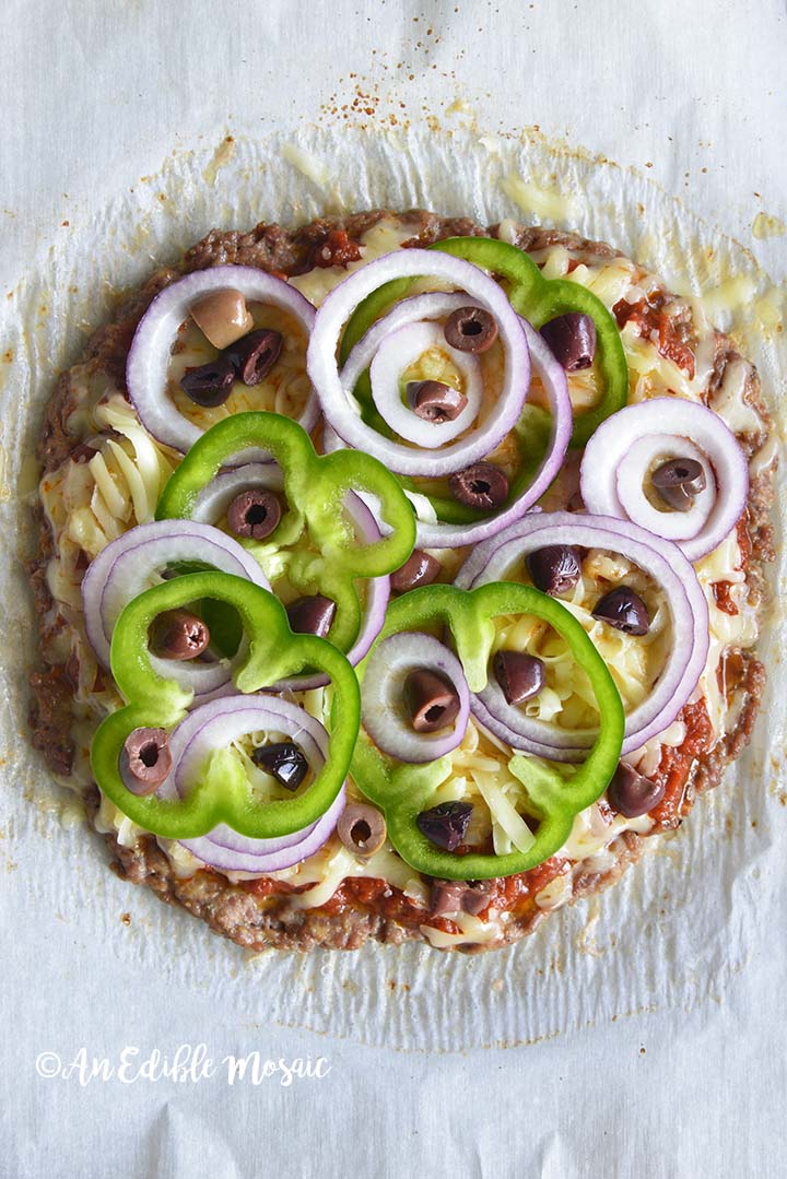 Meatza with Toppings Before Baking