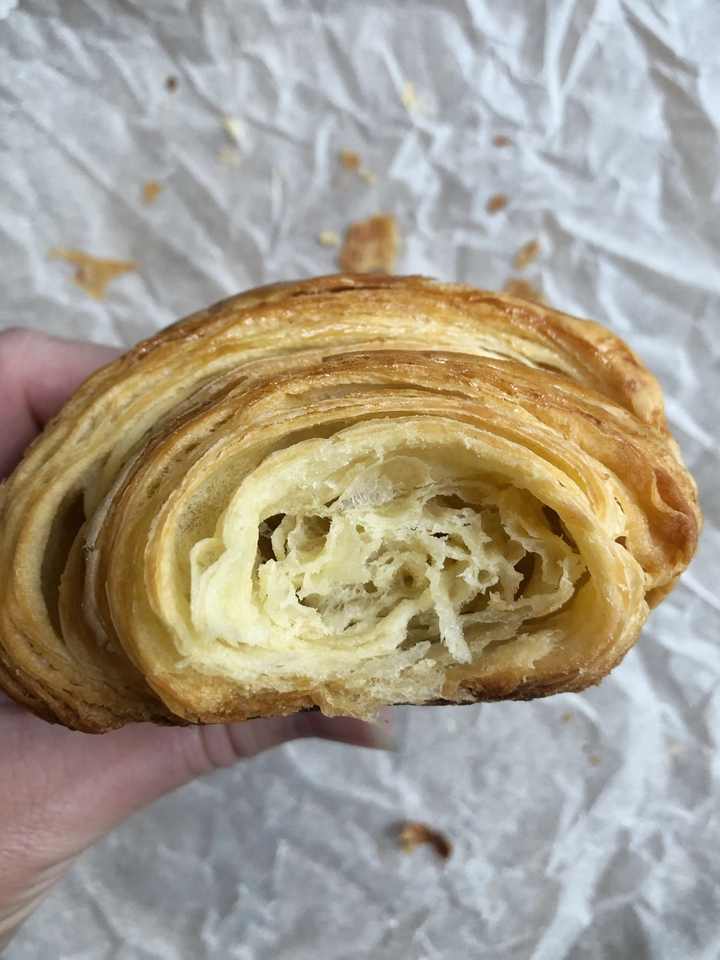 Inside of an All-Butter Croissant on White Parchment Paper