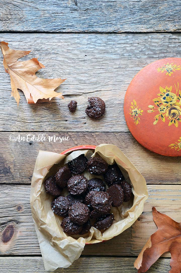 Salted Dark Chocolate Cookies with Autumn Leaves on Wooden Table
