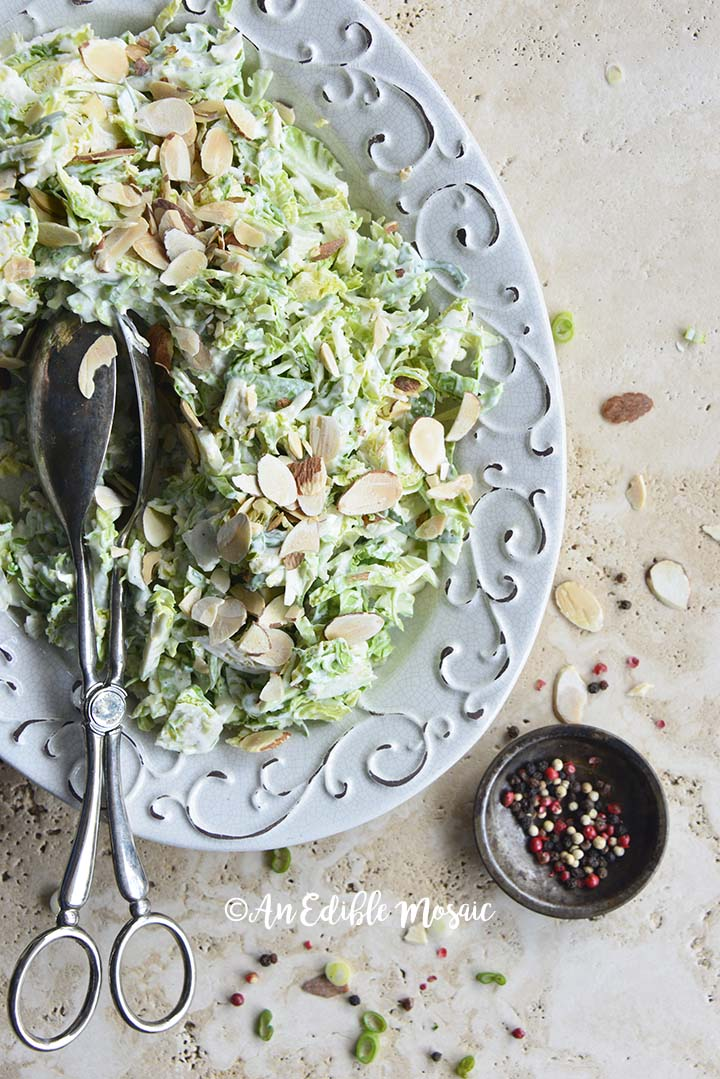 Top View of Brussels Sprouts Salad on White Platter with Swirl Design