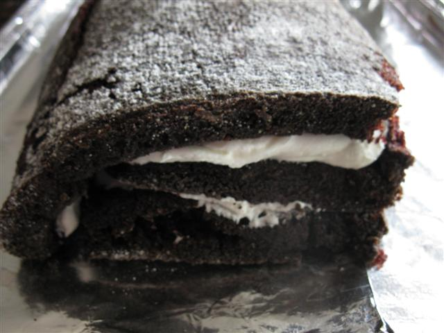 With a Spongier Cake Recipe, You Could Leave the Cake and be Done at This Point...This Cake is too Moist and Cracks too Much (But it's so Good!)