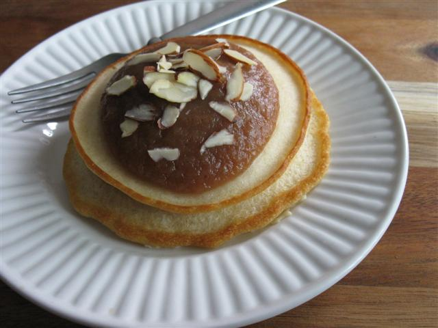 Pancakes Topped with Warm Apple Butter and Sliced Almonds (Mix 1 part apple butter with 1 part water)