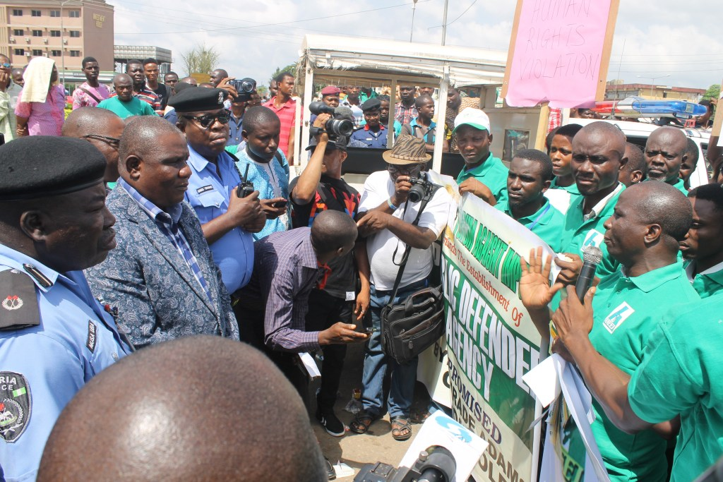 Rev David Ugolor delivering a message to the Clerk of Edo State House of Assembly during the rally