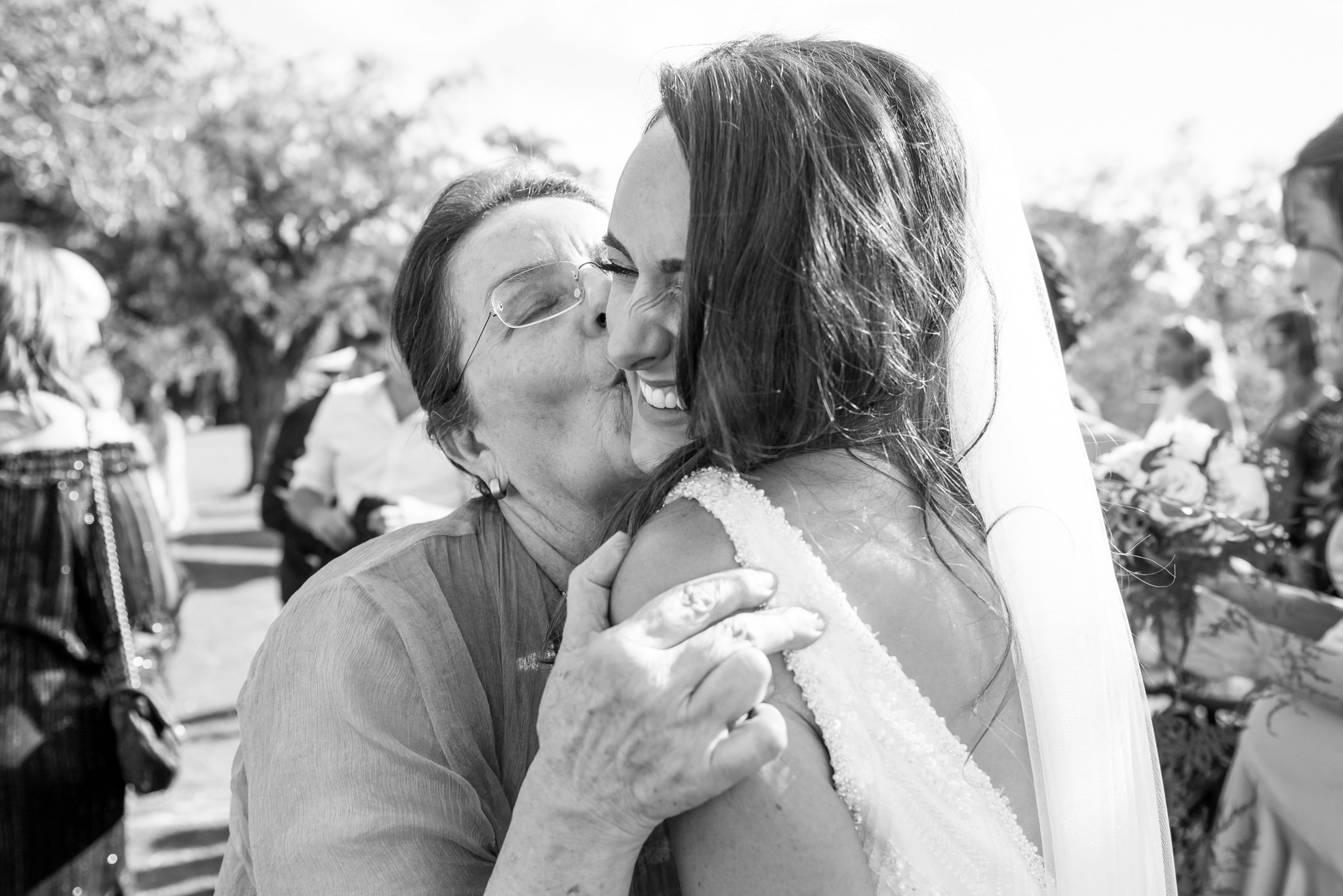 bride getting kissed by grandmother