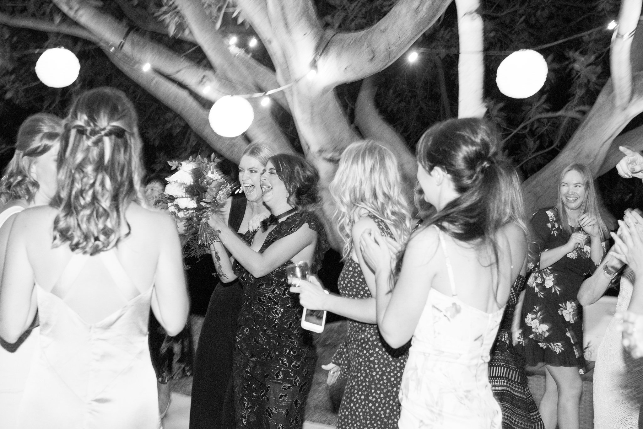 girls catching the bouquet