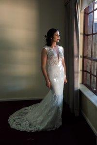elegant bride by the window