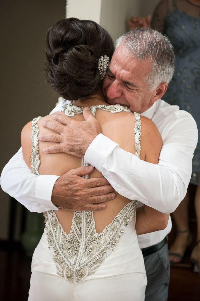 father of the bride hugging his daughter