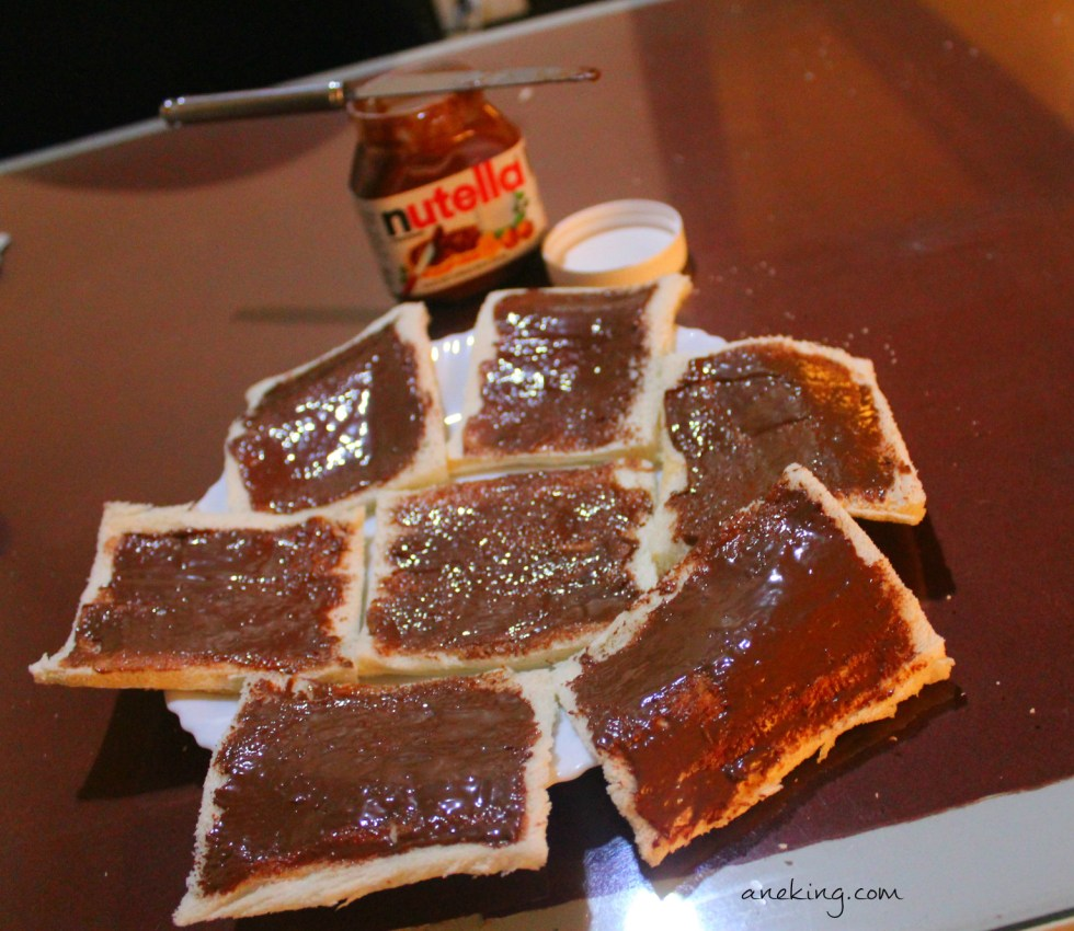 4. Spread our favorite, Nutella, on each bread.