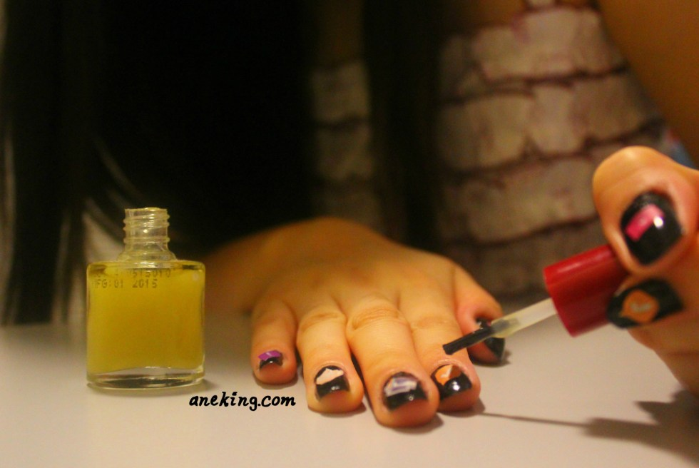 5. End your nail art with a top coat.