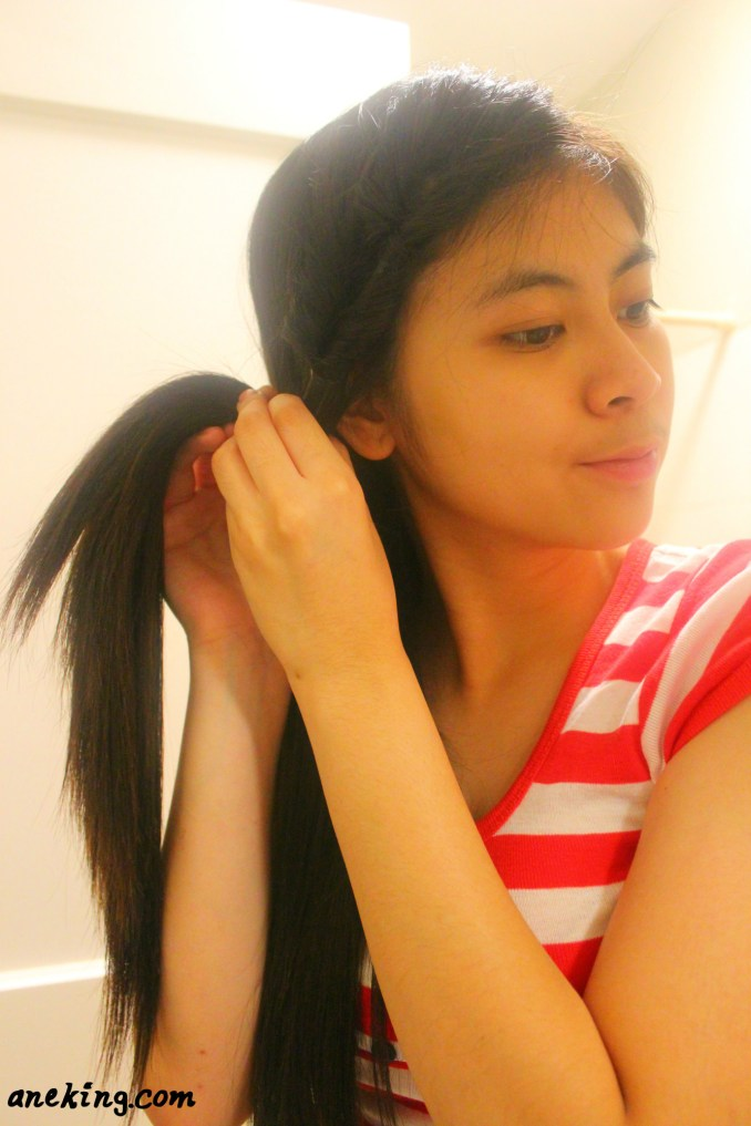 7. Continue doing an inverse ponytail until all your hair is tied.