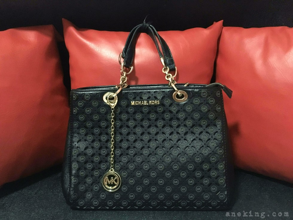 black holed Michael Kors bag