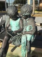 Brass sculpture - Children reading