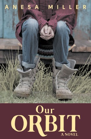 The fully redesigned cover the Booktrope edition of OUR ORBIT features a photograph of a young girl, from the shoulders down, seated on a bare wooden porch step, hands clasped between her knees. She wears a red-and-black checked shirt, old jeans, and oversized lace-up boots.