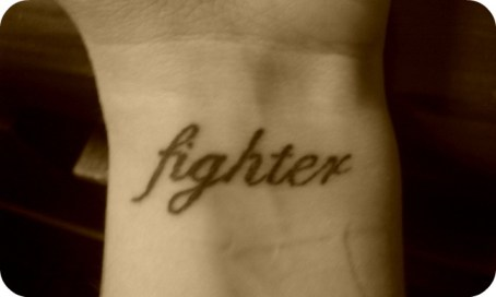 fighter wrist tattoo