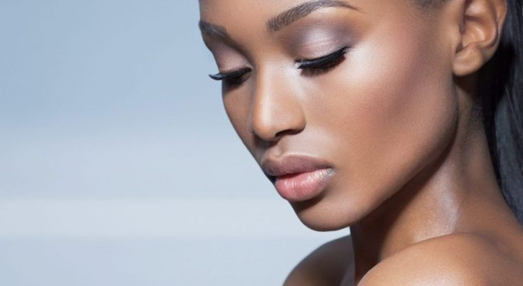 woman with glowing skin that can be achieved by custom chemical peels